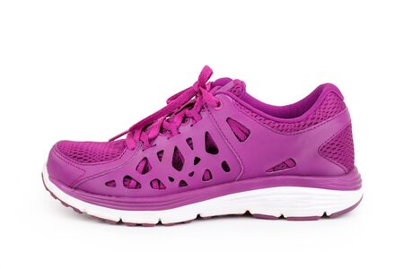athletic wear: Violet sport running shoes isolated on white background