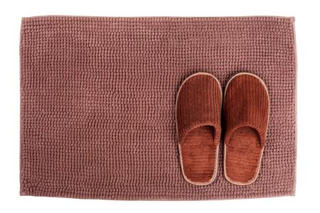 slipper: Brown wool slipper on mat