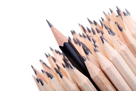 sharpened: One sharpened black pencil among many ones