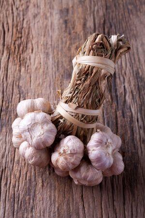 garlic clove: garlic on wooden background Stock Photo