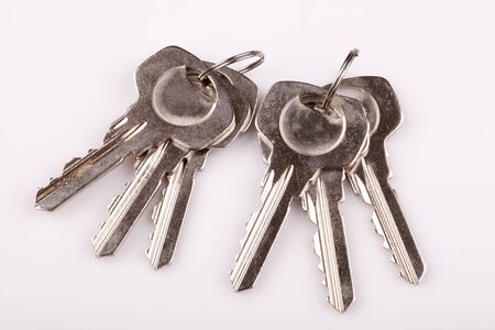 key: Set of old house keys  on white background Stock Photo