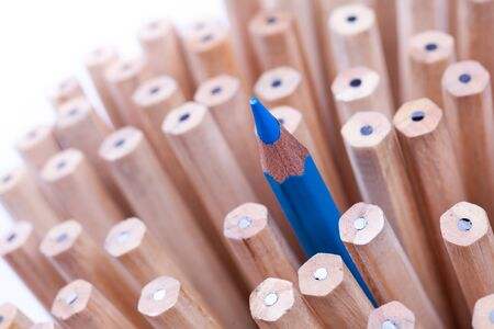 sharpened: One sharpened blue pencil among many ones