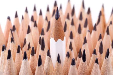 sharpened: One sharpened white pencil among many ones