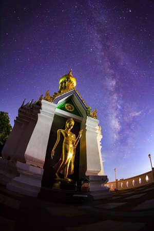 vulpecula: Milky Way at Standing gold Buddha image name is Wat Sra Song Pee Nong in Phitsanulok, Thailand