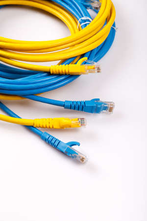 cat5: Yellow and Blue Network Cable with molded RJ45 plug