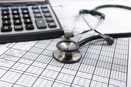 high cost of healthcare: stethoscope on blank Patient information