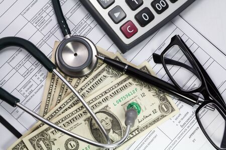 health care costs: Health care costs. Stethoscope and money symbol for health care costs or medical insurance Stock Photo