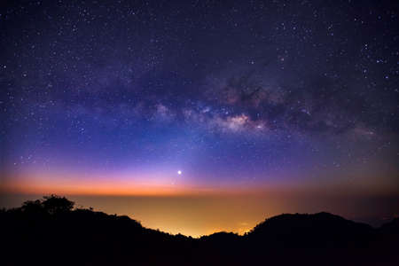 2 way: Milky Way Galaxy at Doi Luang Chiang Dao is a 2,225 m. high mountain in Chiang Mai Province, Thailand..Long exposure photograph.With grain