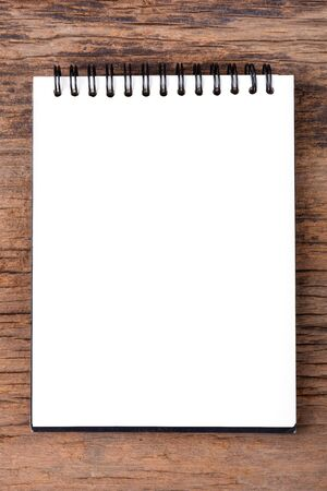 note pad: Blank empty notepad on wood background