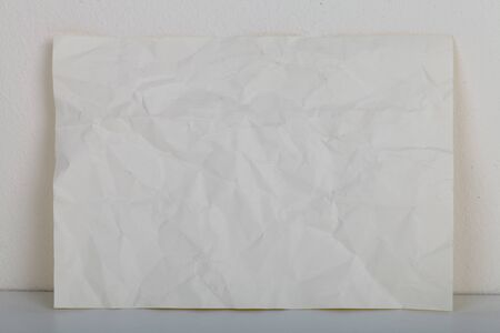 wrinkled paper: wrinkled paper at cement wall background texture