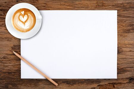lapiz y papel: blank paper with pencil and a cup of coffee on wooden