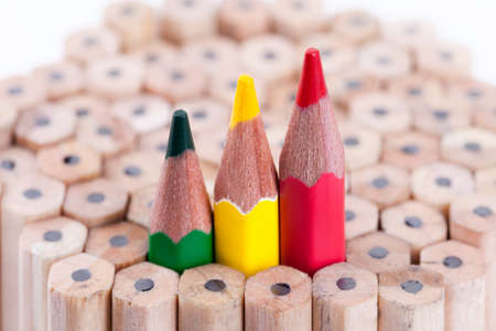 sharpened: three sharpened green,yellow,red pencil among many ones