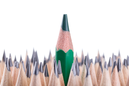 One sharpened green pencil among many ones Stock Photo