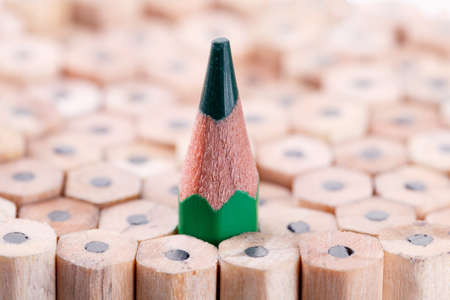 among: One sharpened green pencil among many ones Stock Photo