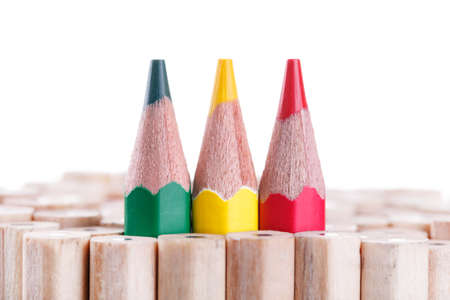 special individual: three sharpened green,yellow,red pencil among many ones