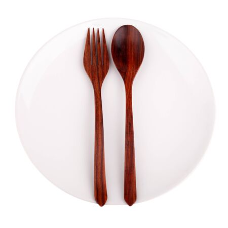 Wood spoon, fork and plate isolated on white background