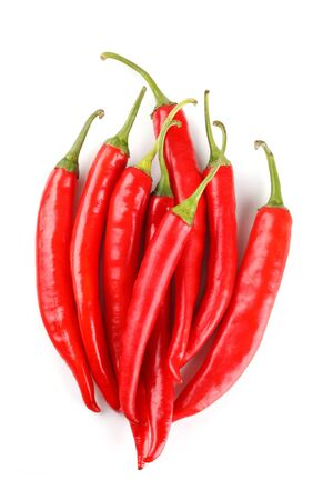 red chili or chilli cayenne pepper isolated on white background Фото со стока