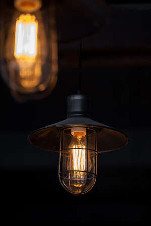switched: A classic Edison light bulb switched on