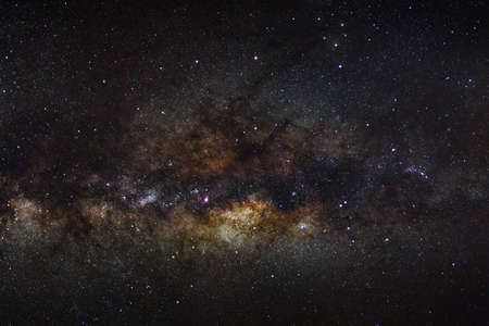 outerspace: milky way galaxy on a night sky, long exposure photograph, with grain.