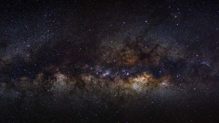 outerspace: Panorama milky way galaxy on a night sky, long exposure photograph, with grain.