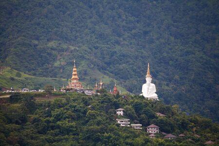 grand sons: White buddha in Wat Phra That Pha Son Kaew temple at Phetchabun Thailand