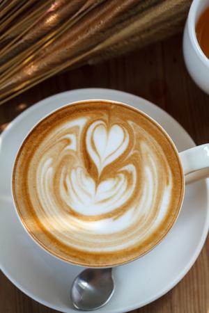latte art coffee on wood background