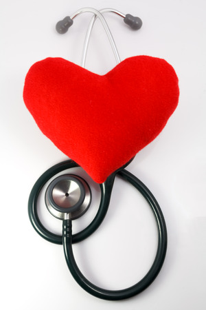 heart sounds: Red fabric heart with stethoscope