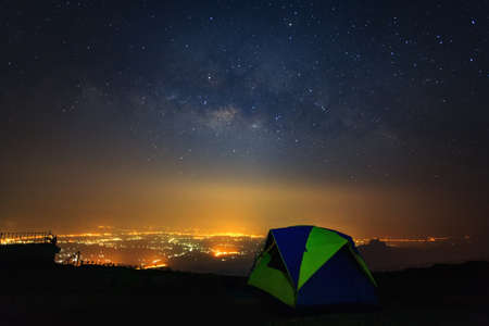 Milky way galaxy with dome tent at Phutabberk Phetchabun in Thailand.Long exposure photograph.With grain Stock Photo