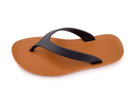 Brown rubber flip flops on a white background Stock Photo
