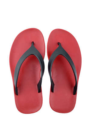 red rubber flip flops on a white background