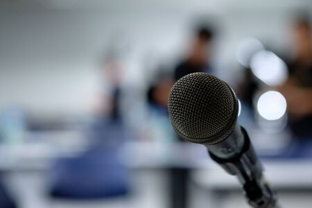 Microphone on the abstract blurred photo of seminar room background
