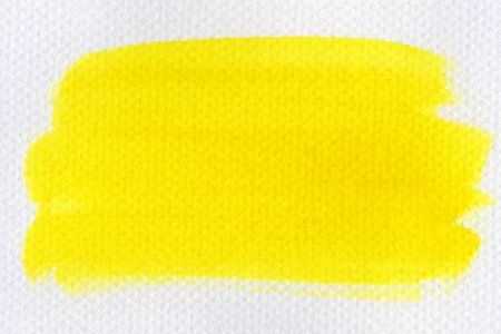 Abstract yellow watercolor on white background.The color splashing on the paper.It is a hand drawn. Stock Photo