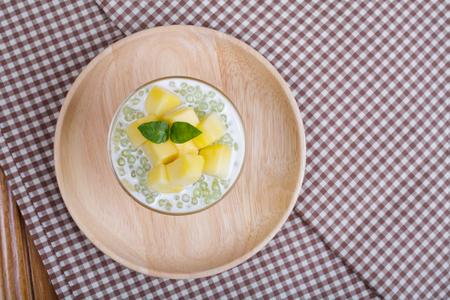 Thai dessert of tapioca pearls pudding with mango