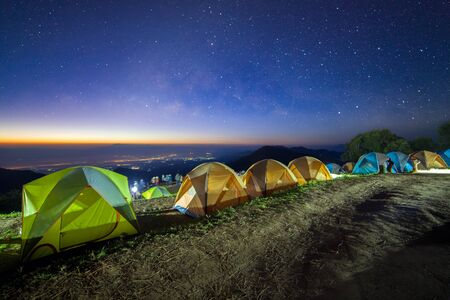 Starry night sky with tent at Monson viewpoint Doi AngKhang and milky way galaxy with stars and space dust in the universe Stock Photo
