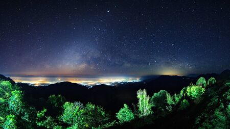 Starry night sky at Monson viewpoint Doi AngKhang and milky way galaxy with stars and space dust in the universe Stock Photo