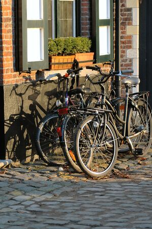 A familys bicycles sitting in front of their house in Brugges, Belgium