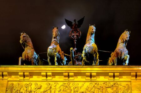 Chariot on top of Brandenburg Gate with moon and haze