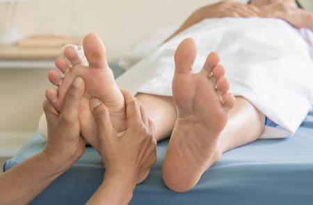 Foot Massage  old women Archivio Fotografico