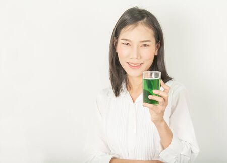 women and green drinks Chlorophyll for health and beauty on white.