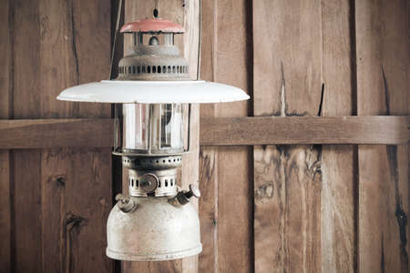 Old lamps and old wooden house walls
