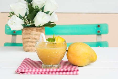Mango juice in glass on table cloth and mango fruit, Reklamní fotografie