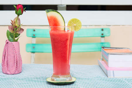 red water melon and lemon in glass on food table