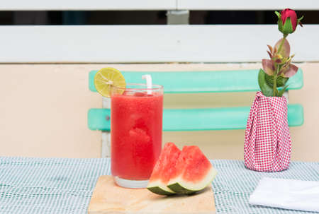 red water melon in glass on food table