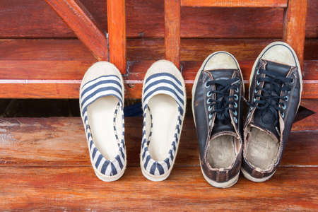 shoes man and woman on wood deck