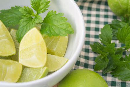 green lemon fresh in bowl