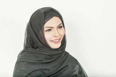 Smiling girl in hijab covering beautiful with happiness and color wall