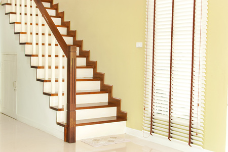 wood blinds: The wooden stairway and wood blinds