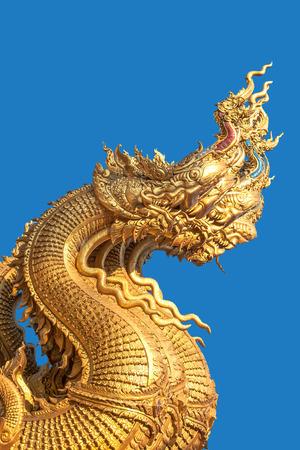 loch: Golden dragon head on a blue background .
