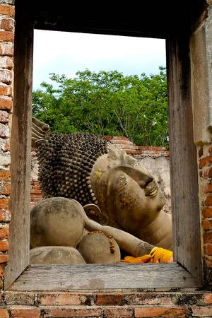 reclining: Reclining Buddha in window