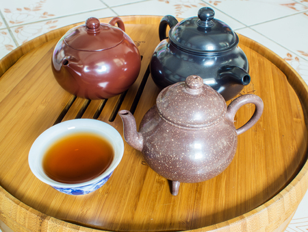 stand teapot: Chinese Teapot on teapot stand, made of bamboo.